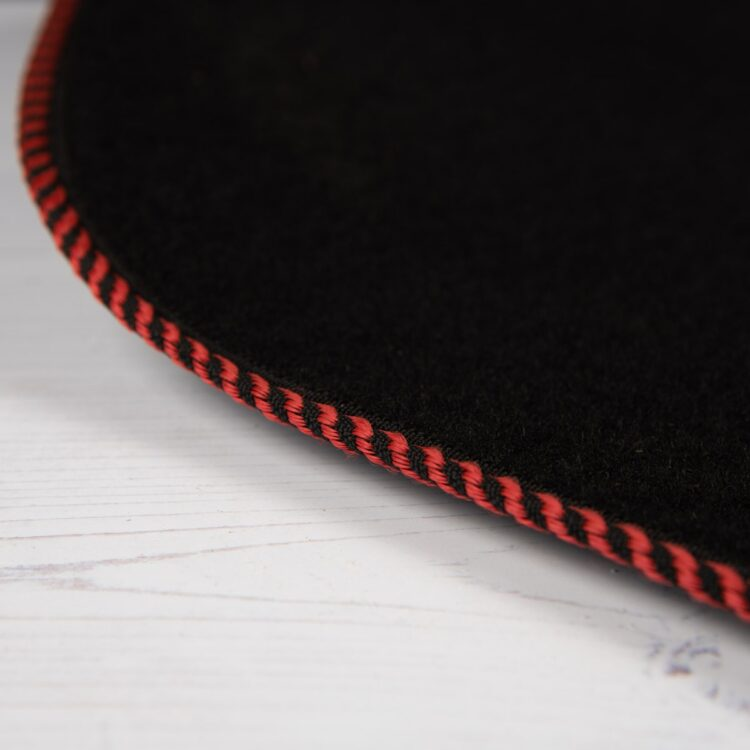 car mat with red trim